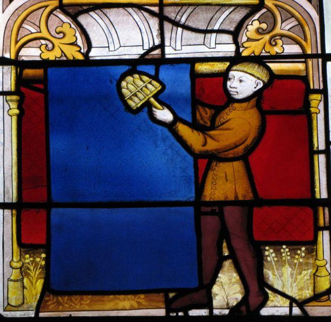 Vitrail avec cardère à Notre Dame dans la ville de Semur en Auxois